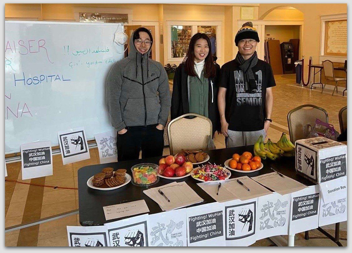 Longxiang Xiao and his friends fundraising for face masks at MIU's Argiro Center