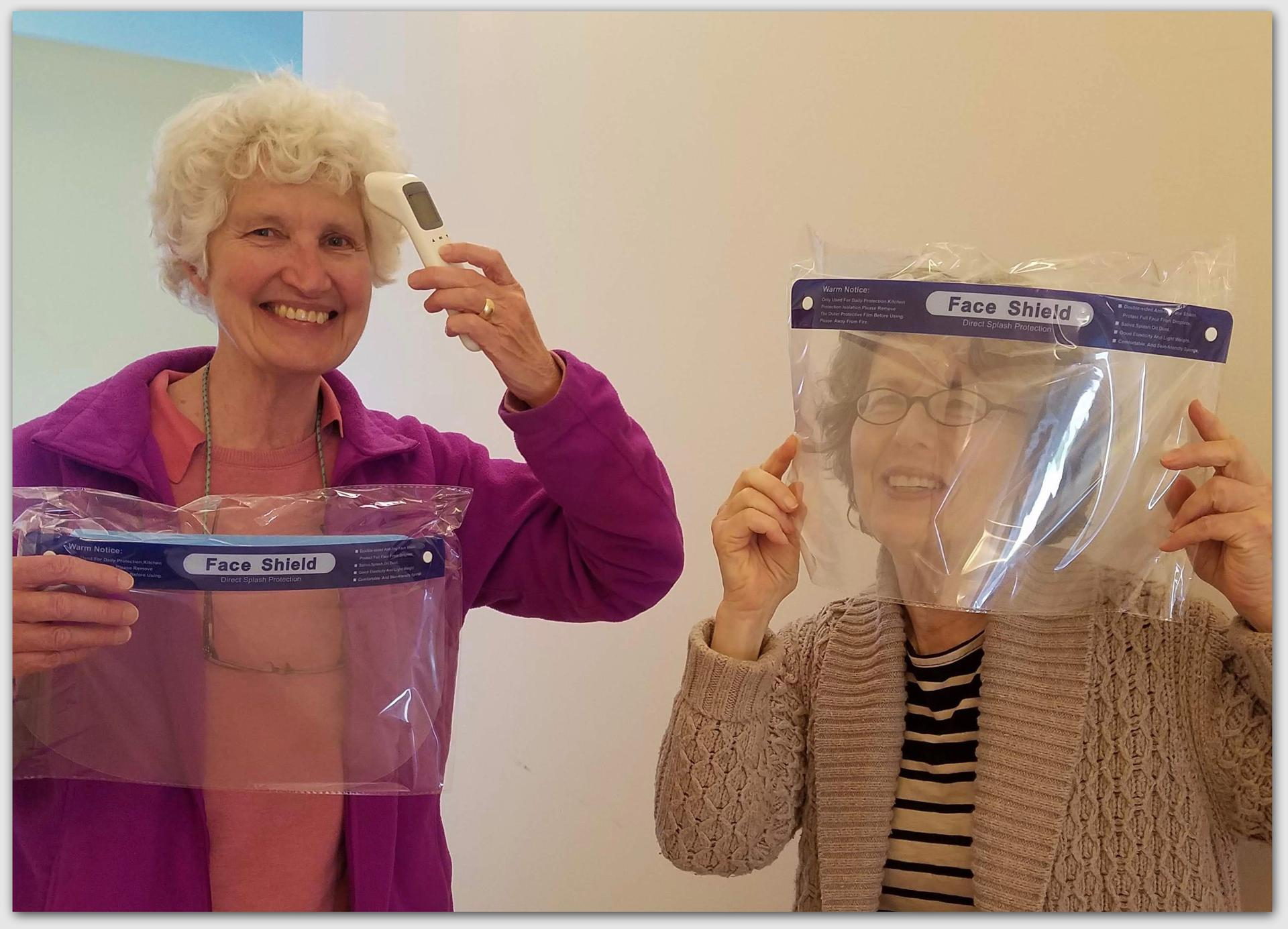 Nurses Vina Miller and Sallie Morgan with the face shields and infrared thermometer received from Mr. Xu.